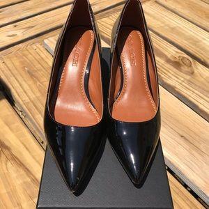 Coach black patent mid heel pump FG1479 with box.